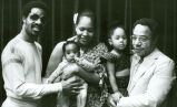 Photograph of Stevie Wonder and his family with Alex Haley
