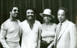 Photograph of Alex Haley, Stevie Wonder, and two others