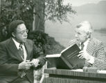 Letter from Johnny Carson to Alex Haley with photo of Carson looking at a book Haley created for...