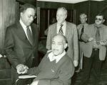 Photograph of Alex Haley with boxer Joe Lewis