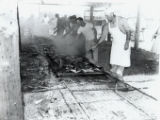 Photographs - - 1950s - - Men turn the meat at a barbecue in Davie.