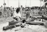 Photographs - - 1930 - - Seminole woman cooks / photograph by Alexander Linn.