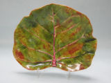 Artifacts - - 1960s - - Earthernware sea grape leaf plates.
