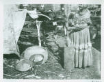 Photographs - - 1908 - - Mammy Jumper pounding corn with mortar and pestle / photograph by M.R....