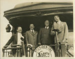 Photographs - - 1933 - - Franklin Delano Roosevelt with son Elliott, a railroad official and Mayor...