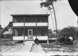 Image of a House and Automobile
